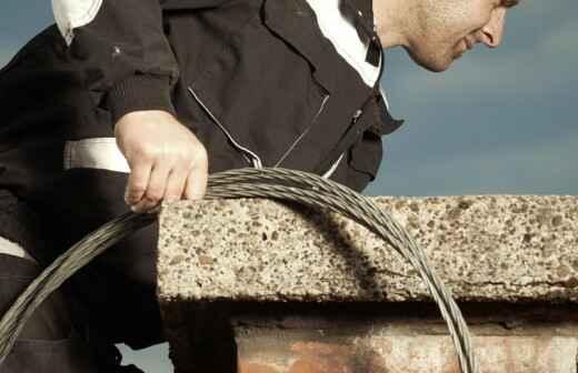 Kamin- und Schornsteinreinigung - Kehrmaschine
