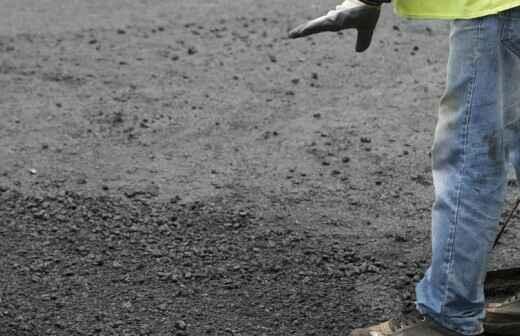 Asphalt reparieren und ausbessern - Pflasterstein