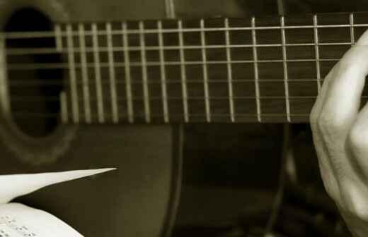 Bassgitarrenunterricht - Dargereicht