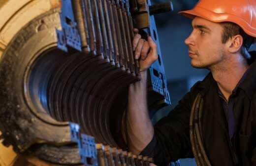 Baumaschine reparieren - Schleifmittel