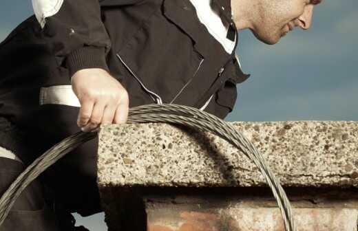 Kamin- und Schornsteinreinigung - Säuberungsaktion