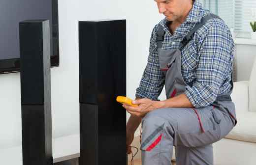 Instalação de Sistema de Som Surround em Cinema em Casa - Reparar