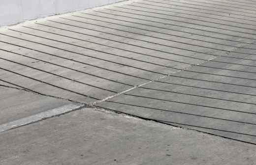 Qual é o preço de colocação e manutenção de Betão / Cimento / Asfalto? Fixando
